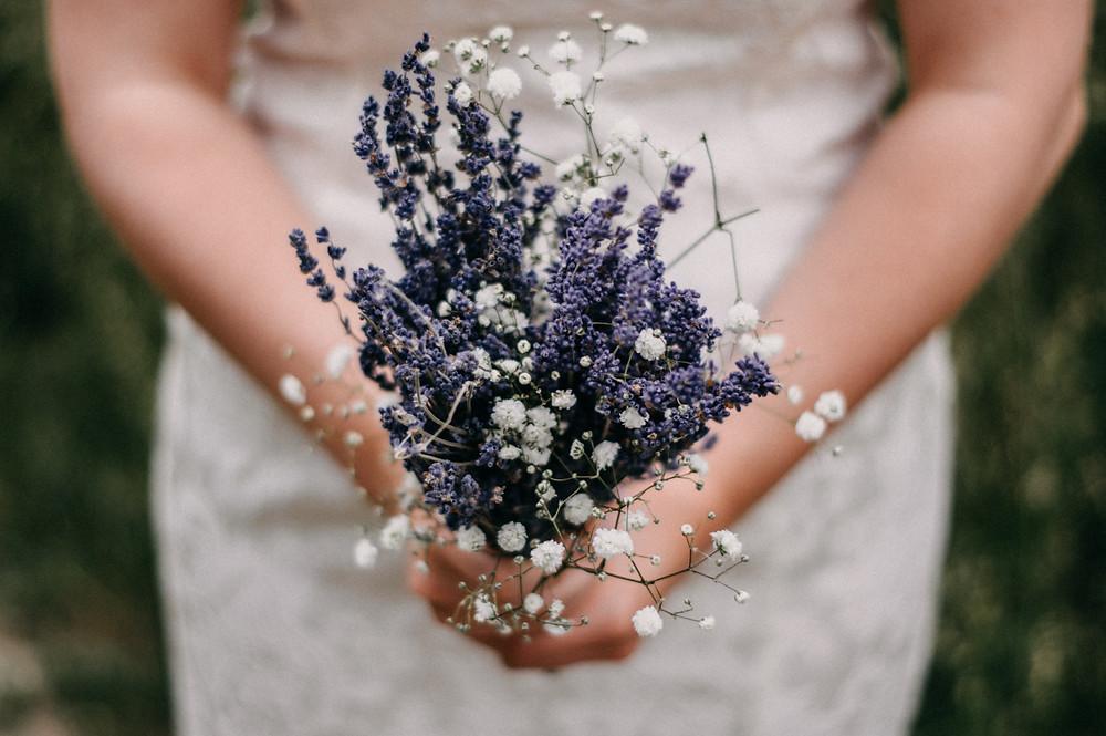 lavender and babys breath bouquet in brides hands