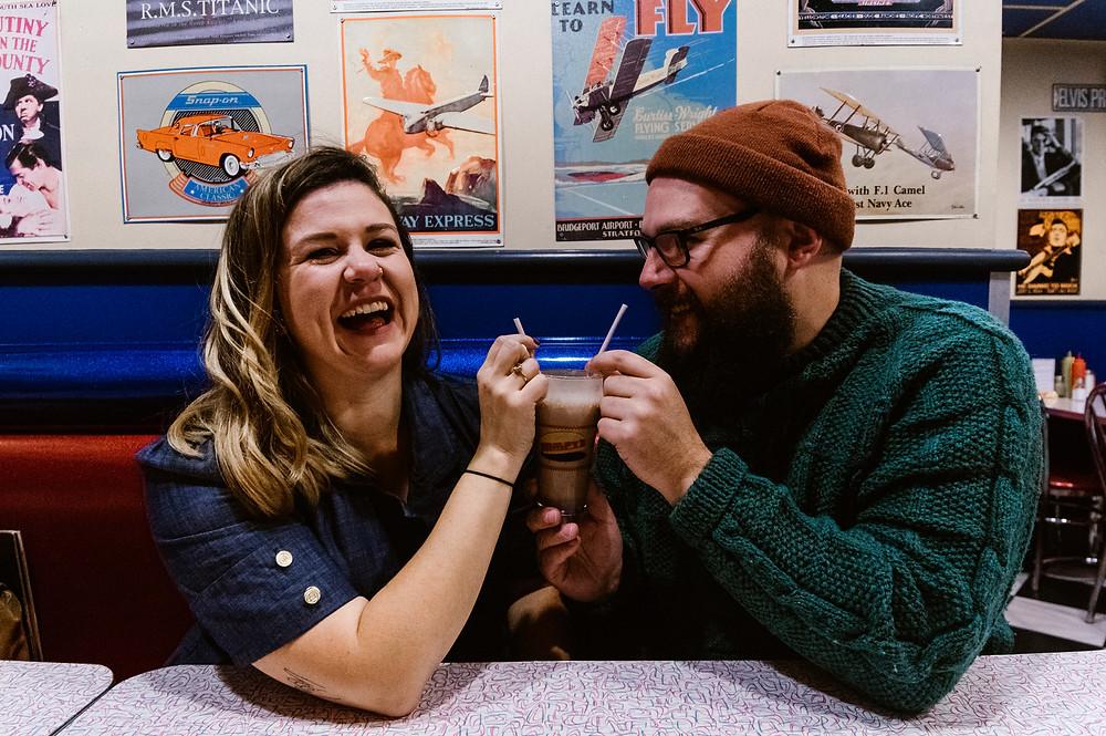 sharing a milkshake engagement photos