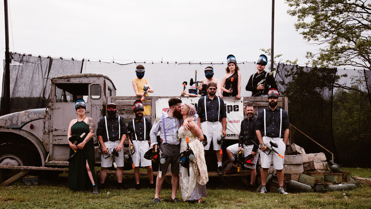 cool wedding party playing paintball
