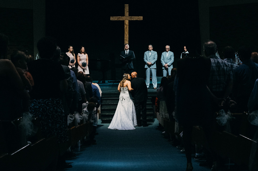 Walking the bride gown the aisle at Compass Point Bible Church