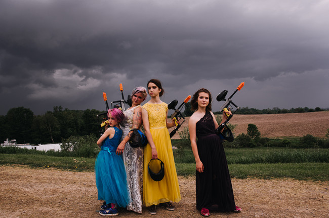 bride and daughters playing paintball