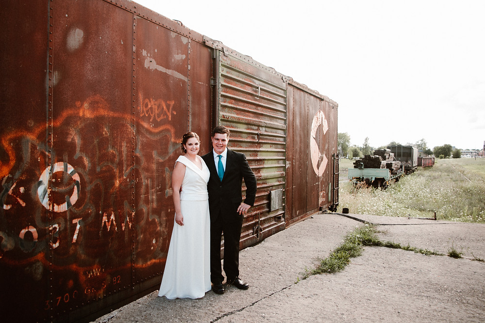 wedding photos in front of old train car