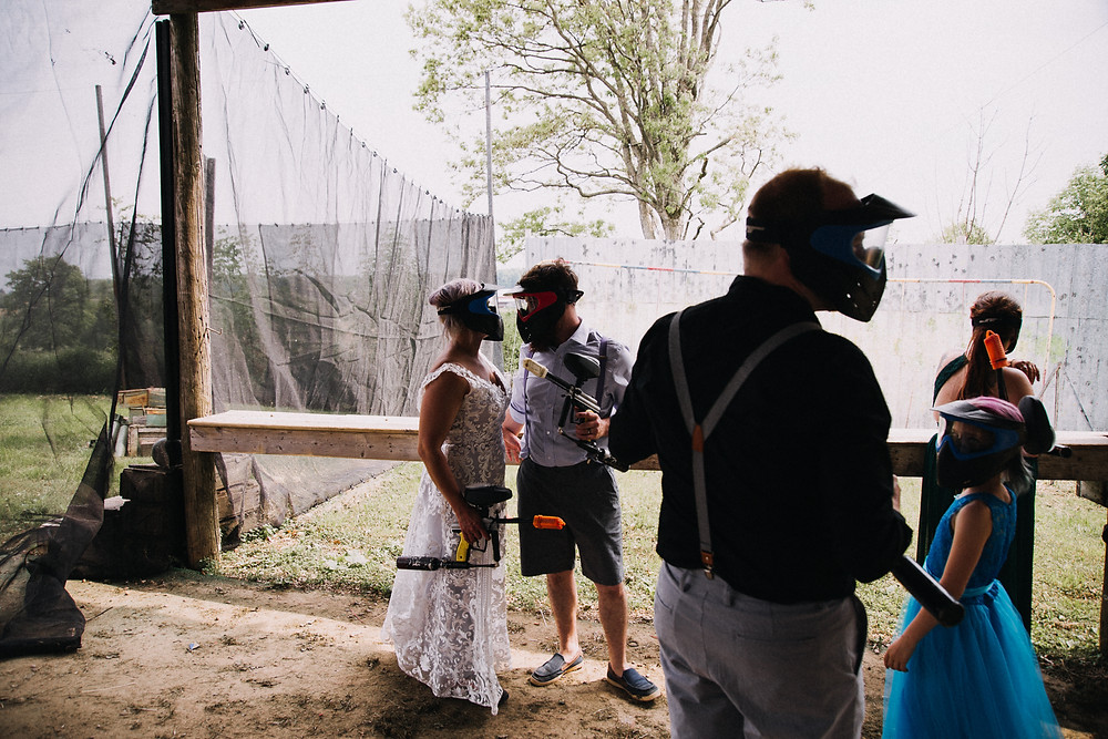 bride and groom paintball