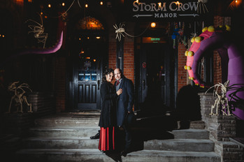 funky bride and groom outside storm crow's manor in toronto
