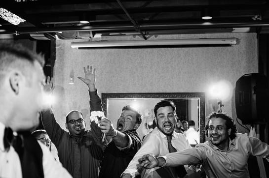 wedding guests try to catch the garter