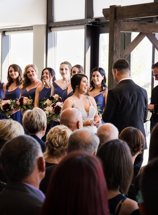 bride laughing during the ceremony