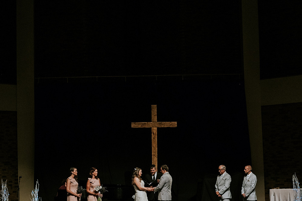 Bride and groom on the altar at Compass Point Bible Church