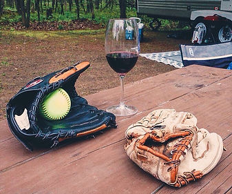 Softbal Gloves and Wine Glass