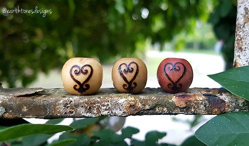 sankofa (heart) adinkra symbol・wood-burned loc bead