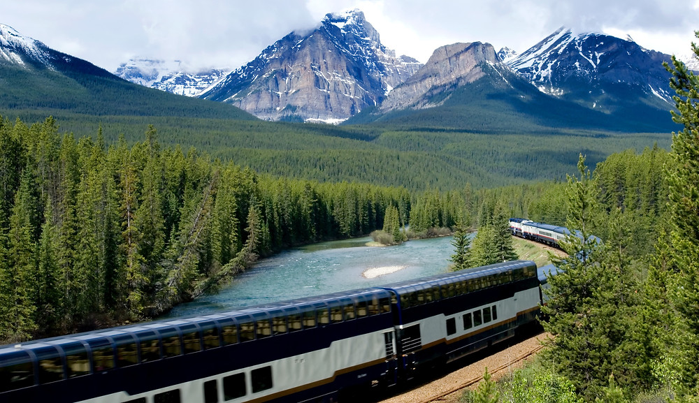 Passenger train passing through the Canadian Rockies
