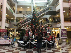 Carol singing in the Whitgift Centre, Croydon, to raise money for the Royal Marsden Hospital, 2018
