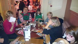 The annual Christmas meal after carol singing in the Whitgift Centre, Croydon, to raise money for the Royal Marsden Hospital, 2014