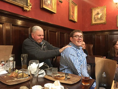 DoM gets a well earned back massage in the pub before Westminster Cathedral, 2017
