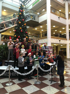 Carol singing in the Whitgift Centre, Croydon, to raise money for the Royal Marsden Hospital, 2018