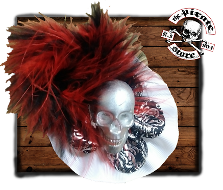 Silver skull with ruby feathers
