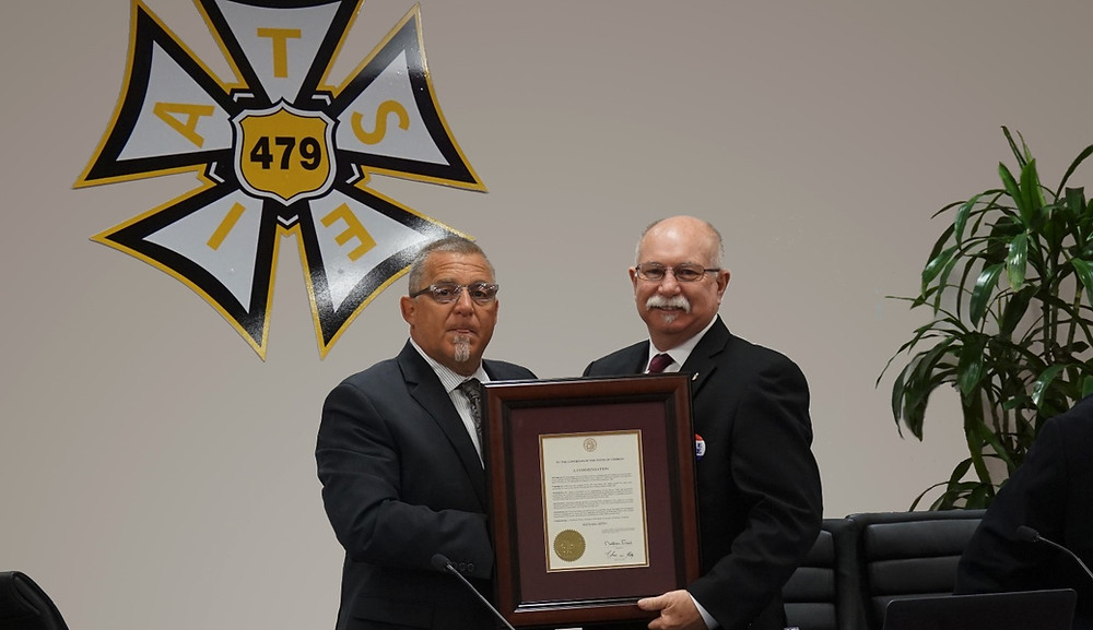 Akins (right) accepts the Governor's Award in 2016