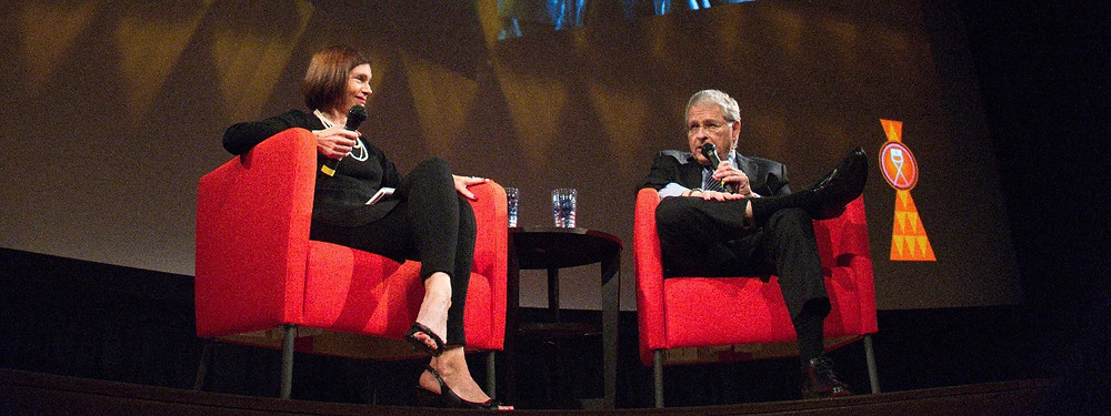 Inaugural Icon Award honoree, Lawrence Kasdan (right), and ArtsATL co-founder, Catherine Fox, sit onstage in the Woodruff Arts Center's Rich Auditorium during a program to honor Kasdan's career