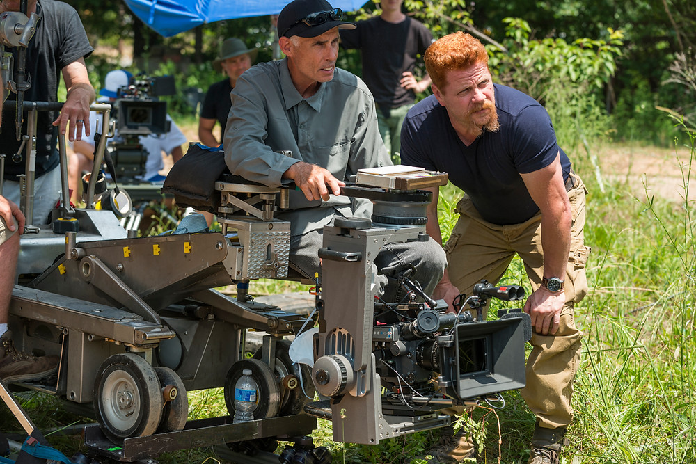 Director of Photography Stephen Campbell talks Michael Cudlitz (Sgt. Abraham Ford) through a Season 7 action sequence. Photo credit: Gene Page/AMC