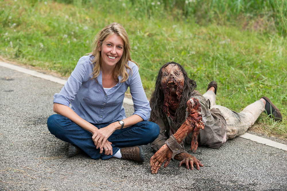Co-Exec Producer Denise Huth gets down with a crawler. Photo credit: Gene Page/AMC