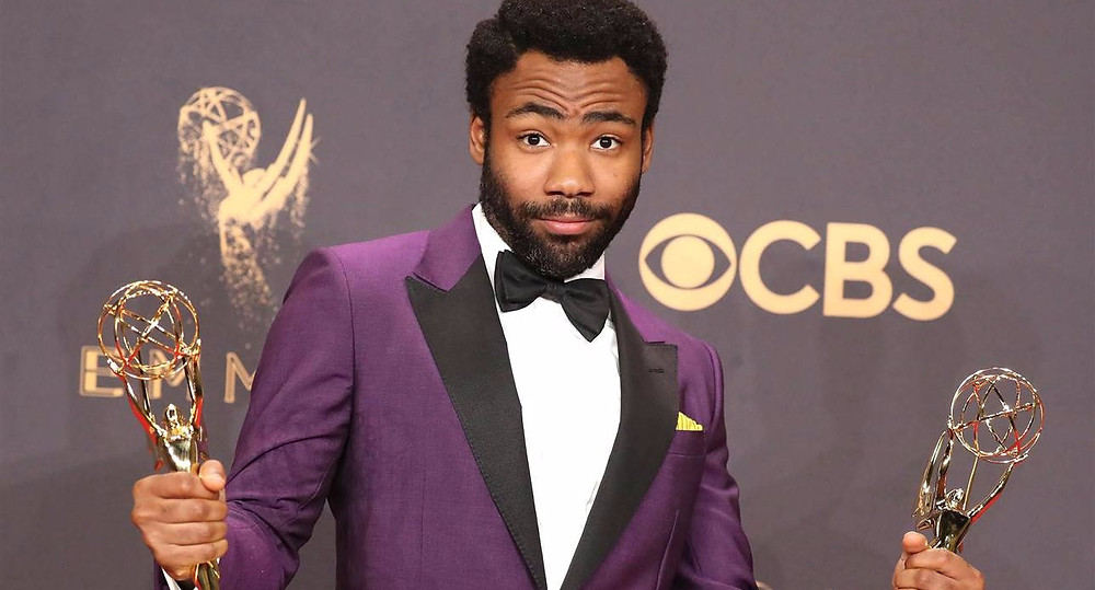 "Donald Glover poses with his Emmy awards for lead actor in a comedy series and comedy series director for his work in ""Atlanta."" Photo credit: Lucy Nicholson / Reuters"