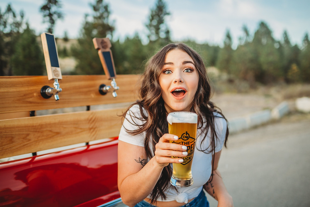 Mobile popup bar serves beer on a truck to cute girl