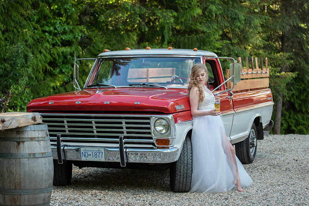 shuswap bride stands in front of beer truck and mobile bar