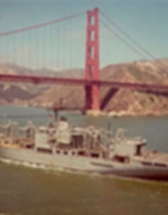 USS San Jose passing under the Golden Gate Bridge on her way out to sea.