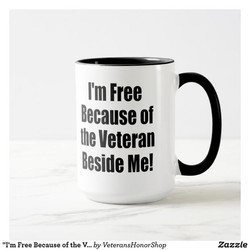 I'm Free Because the Veteran Beside Me Coffee Cup