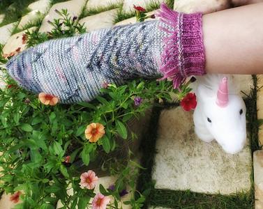 White, grey, & pink unicorn-themed hand knit socks w/ fringe