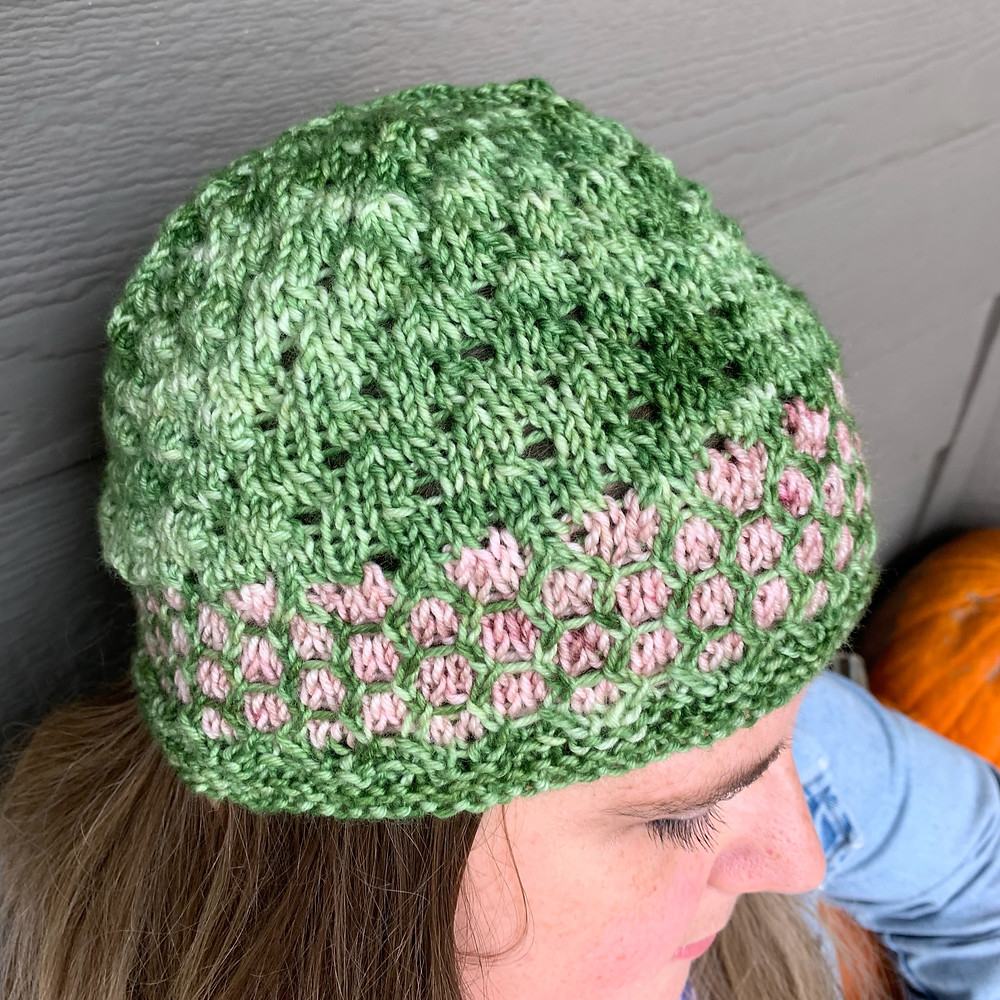 The Chapter by Chapter Cap knitting pattern, an eyelet lace and mosaic knitted hat that utilizes dk weight yarn
