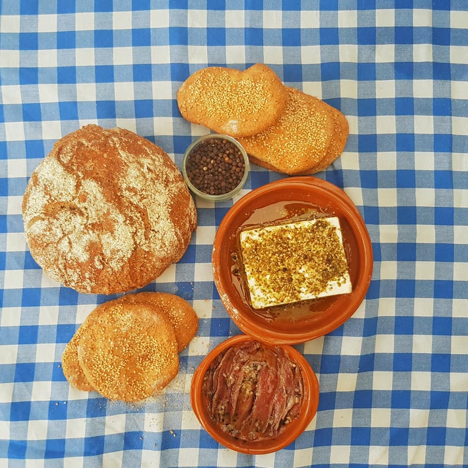 Anchovies, homemade flatbreads, homemade buckwheat bread, cheese, olive oil, sesame and, of course, lots of pepper!