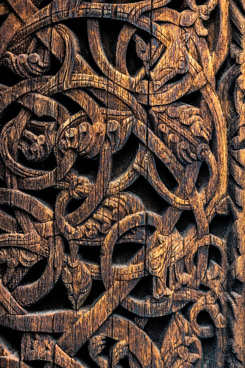 Ornaments of ancient vikings on a wooden