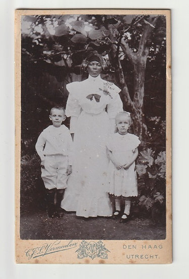 Suriname - Maid and two children, c. 1900