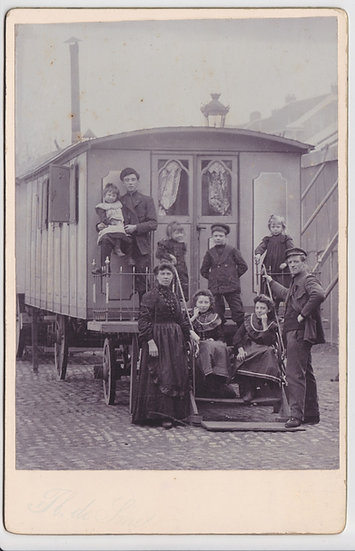 Rare cabinet card of a gipsy family in front of their caravanc. 1890