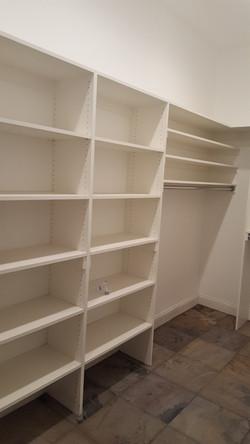 White melamine linen closet install
