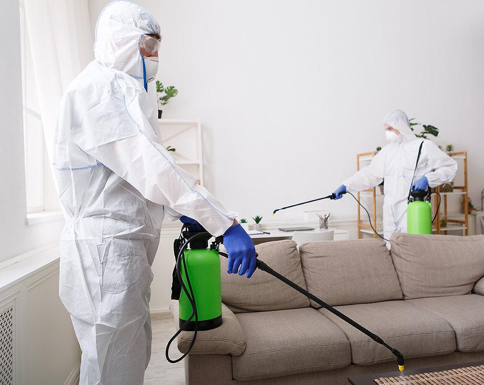 people-in-hazmats-making-disinfection-in