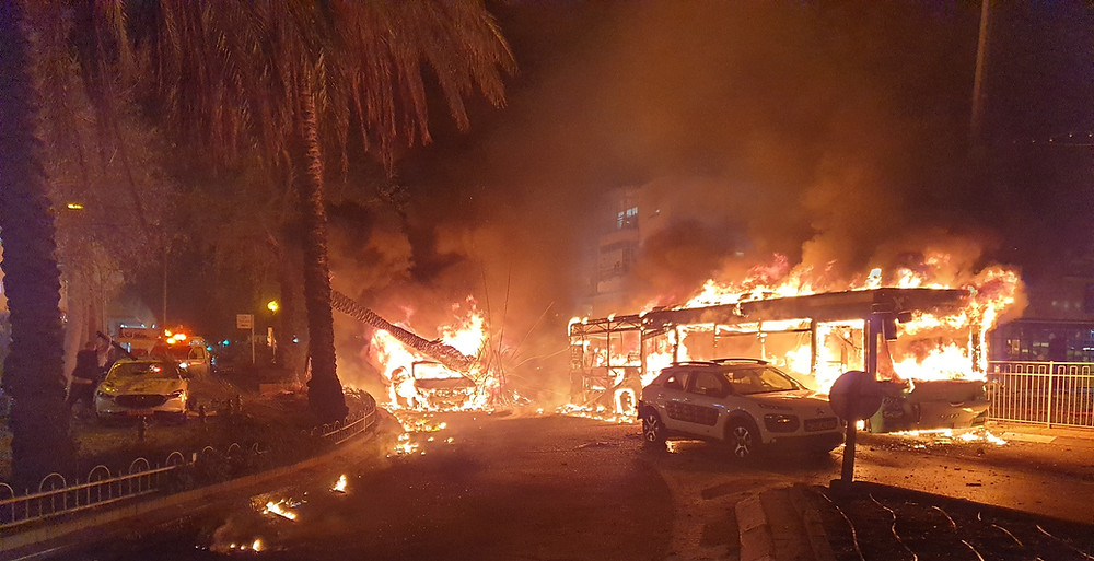 Bus Burns in the Aftermath of Hamas Attack in Holon, Israel - 11 May, 2021 (Image Credit: Aftermath of Hamas Attack in Holon, Israel - 11 May, 2021