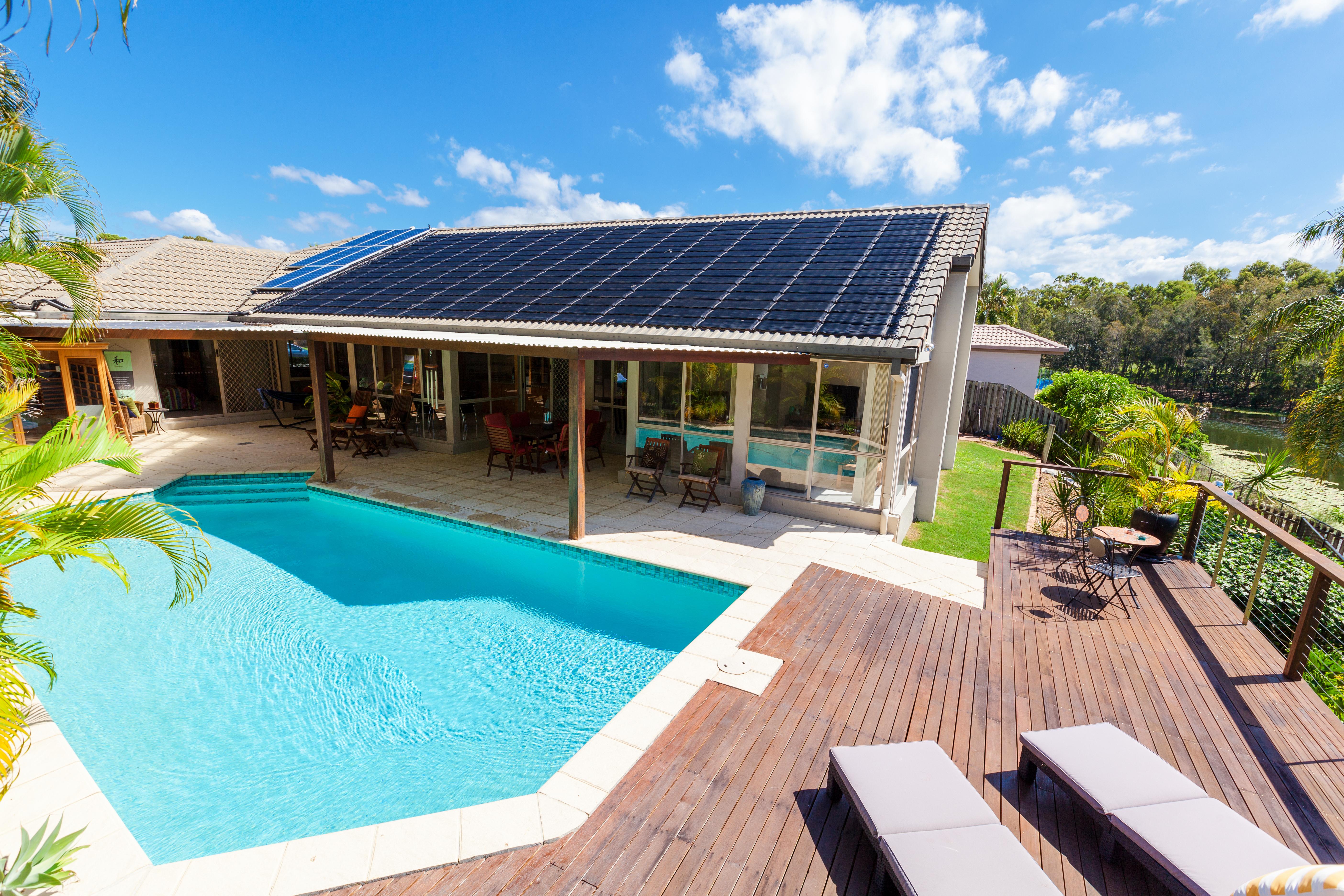 Backyard with swimming pool in stylish h