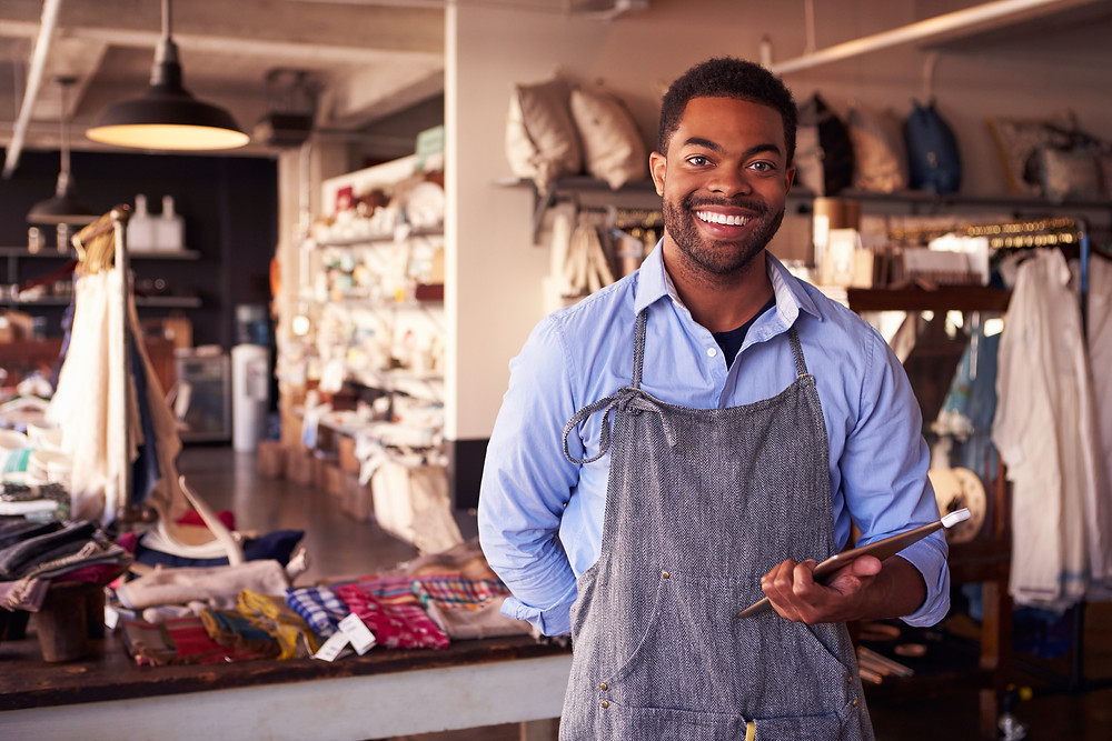 Portrait of a male serving customers