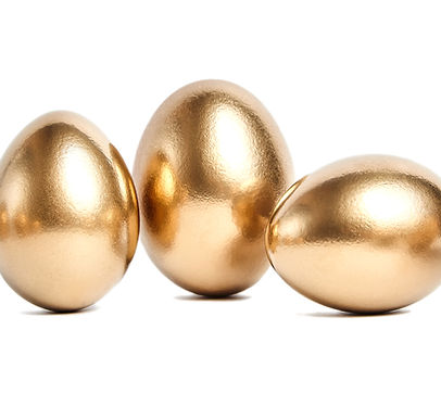 Three golden eggs isolated on white back