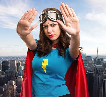 Pretty superhero girl making stop sign w