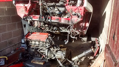 Lancia Delta body lifted over engine
