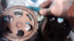 Integrale cam belt tension