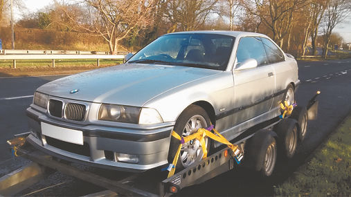 BMW E36 m3 on trailer