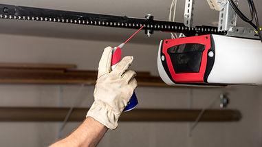 Applying Oil to Chain of Garage Door