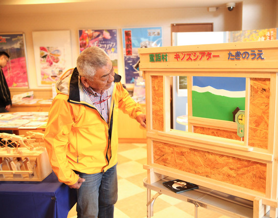 Mr. Takeuchi happily explaining toys