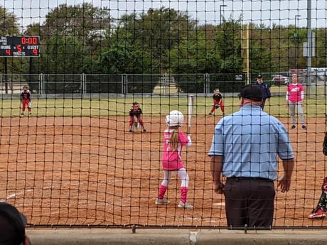 Watching my goddaughter's softball game