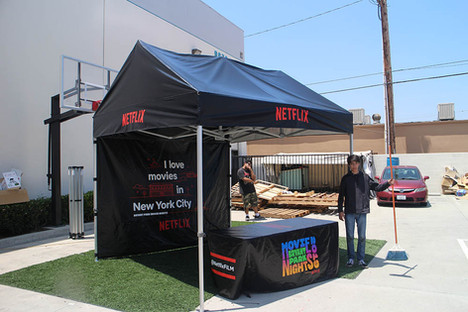 10x10 pop up gable roof frame black canopy and table cover with printed logo Netflix