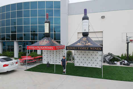 10x10 custom pop up canopies with inflatable product replicas wine bottles riboli