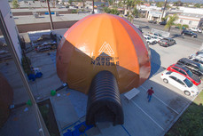 Large inflatable dome tent with tunnel entrance and printed business logo Force of Nature